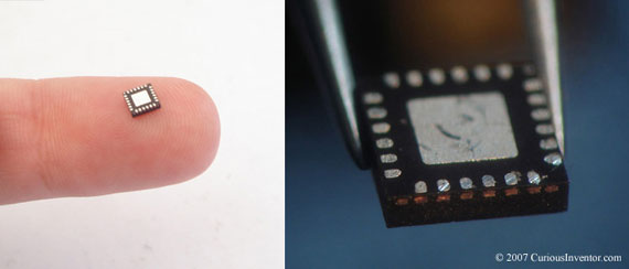 a QFN chip upside-down showing alignment markers on its side